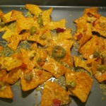 Melted cheddar cheese over hot peppers and Doritos.