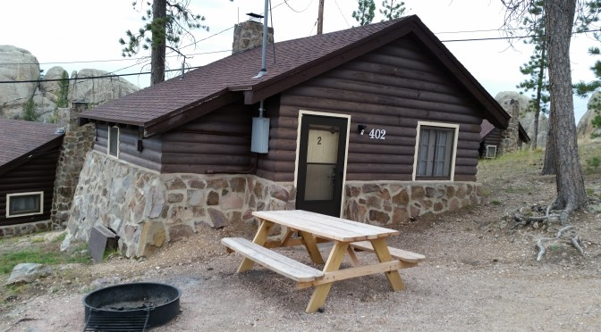 Sylvan Lake Lodge Cabin, picnic table, and fire pit.