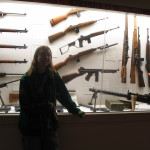 guns on the wall in cases
