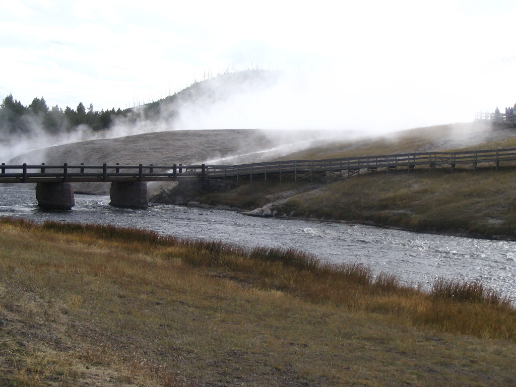 A bridge and steam in Yellowstone