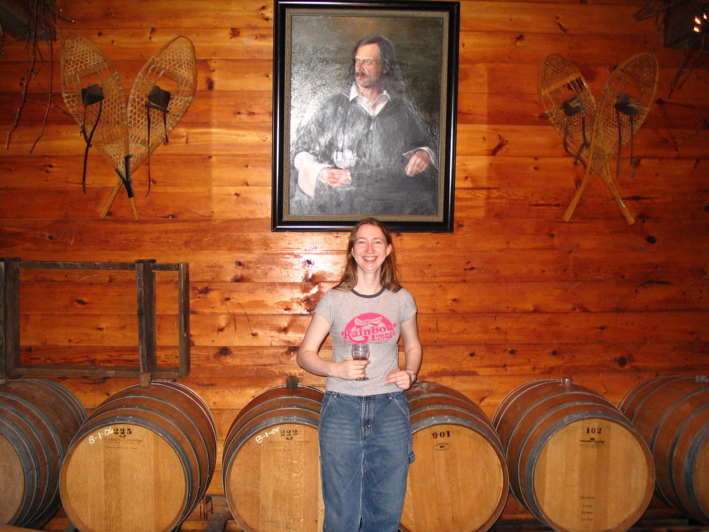 wine casks and portrait at Alexis Bailly
